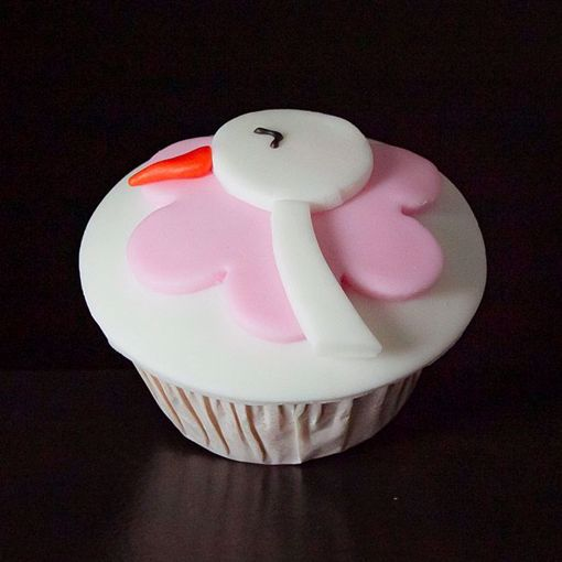 Afbeelding van Muffin baby ooievaar roze